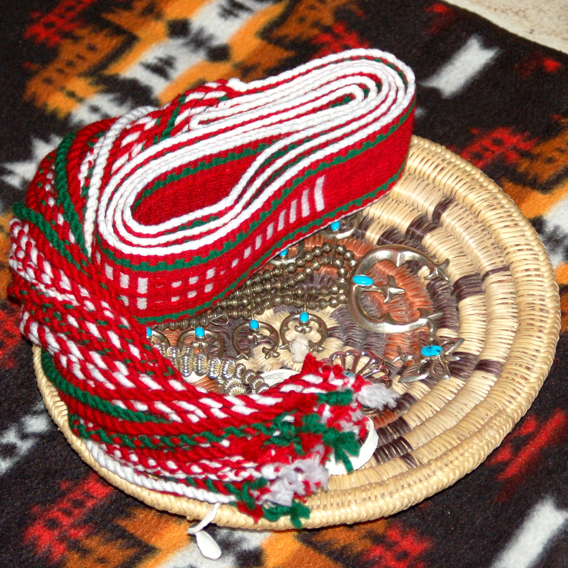 Navajo basket filled with sash belt and jewelry