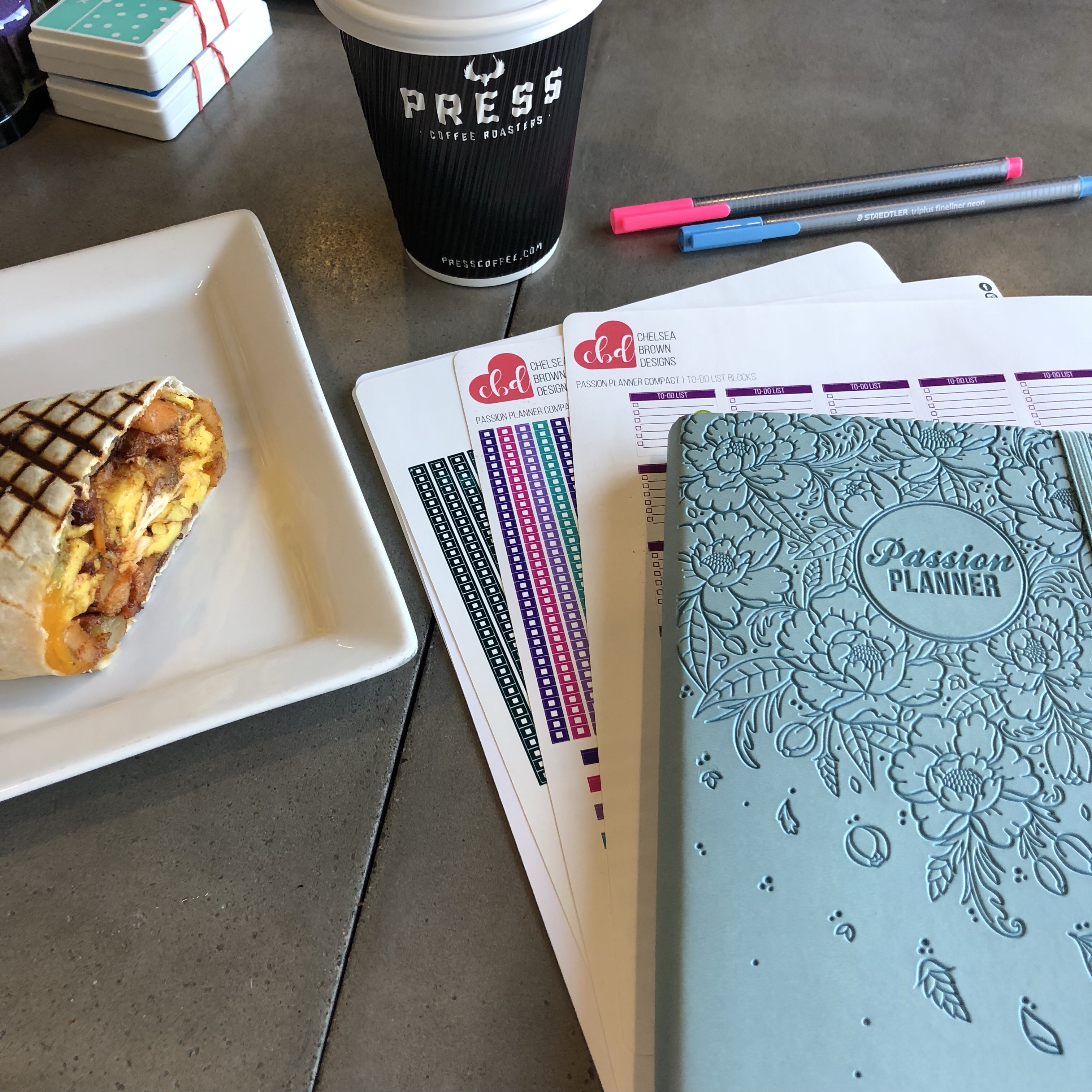 2018 Passion Planner, Chelsea Brown Stickers, pens, and Coffee and burrito